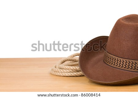 brown cowboy hat and rope isolated on white background - stock photo