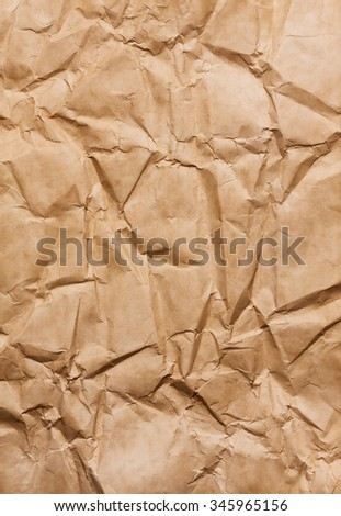 Brown creased paper background texture  - stock photo