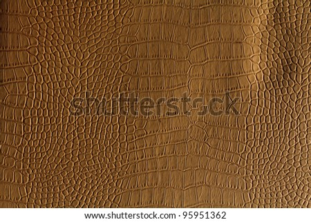 brown crocodile leather texture. closeup. Useful as background for design-works. - stock photo