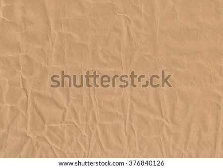 Brown crumpled paper. Old background