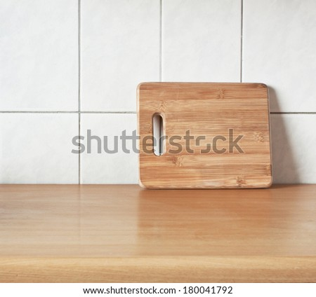 Brown cutting bamboo board for cooking on the table - stock photo