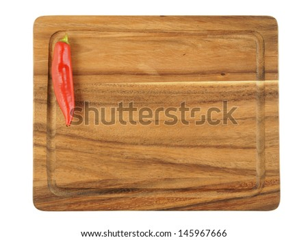 Brown cutting board isolated with pepper on white background