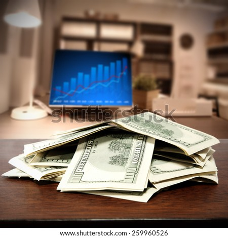 brown desk and dollars  - stock photo