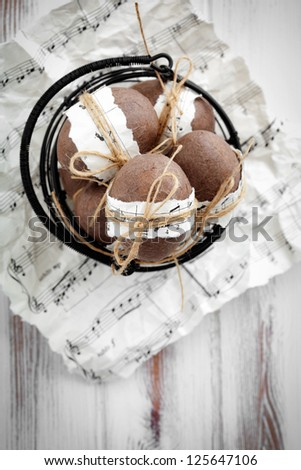 Brown easter eggs with musical notes and ribbon - stock photo