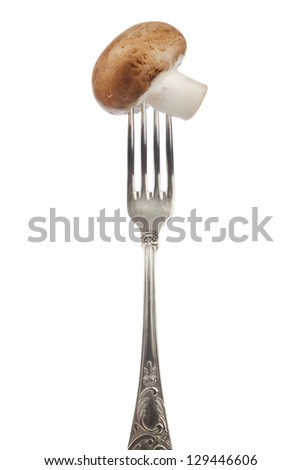 brown edible mushroom on silver fork isolated