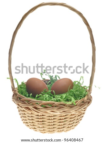 Brown Eggs in Easter Basket - stock photo