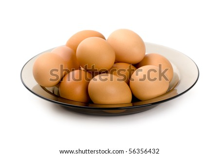 brown eggs in the plate isolated on white background