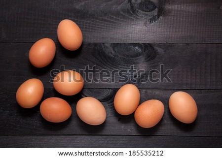 Brown eggs on dark wooden background - stock photo