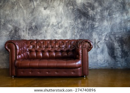 Brown elegant sofa in dark living-room