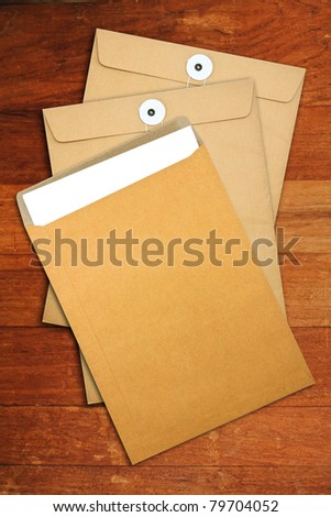 Brown Envelope document  on a wooden desk
