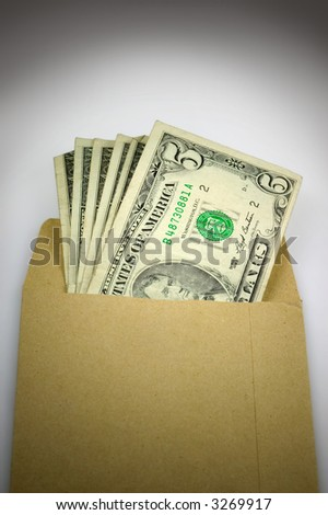 Brown envelope full of cash, bribery and corruption.