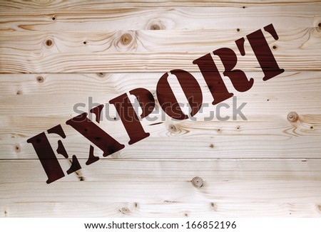 Brown export article on natural wooden background - stock photo