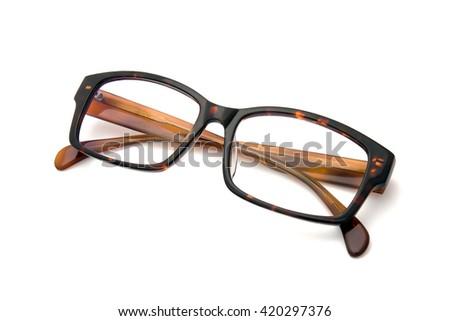 Brown eyeglasses on white background - stock photo