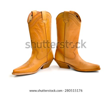 Brown female boots isolated on white background, selective focus.  - stock photo