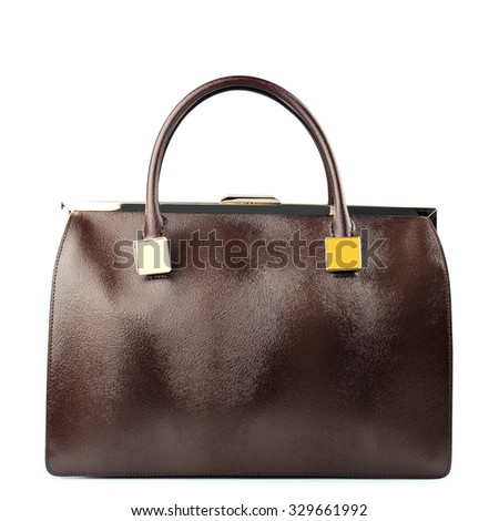 Brown female leather bag isolated on white background.