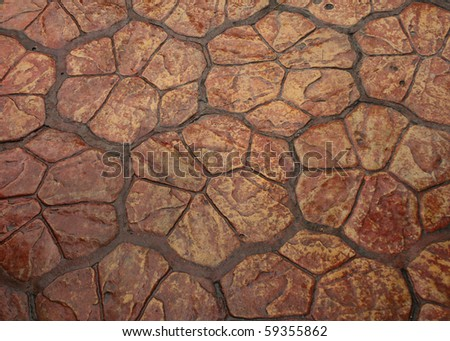 Brown floor tiles useful as a background - stock photo