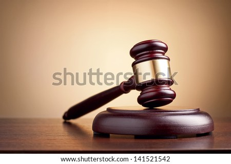 brown gavel on the table on a brown background