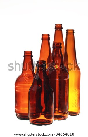 Brown glass empty beer bottles isolated on a white background