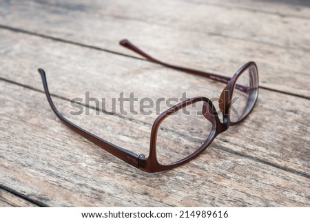 Brown glasses on wood table - stock photo