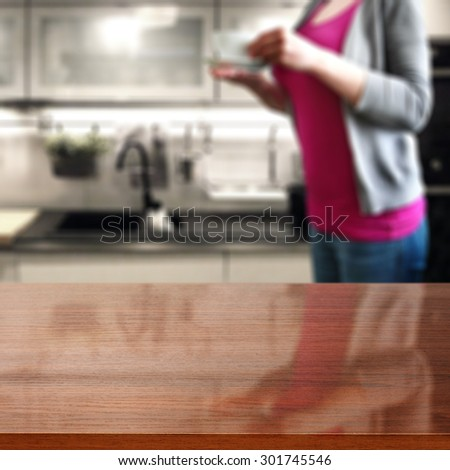 brown glasses top and woman in kitchen with cup of warm coffee