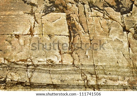Brown granite cliff - the natural background - stock photo