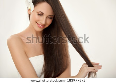 Brown Hair. Beautiful Brunette with Long Hair. Haircare. Spa Beauty Model - stock photo