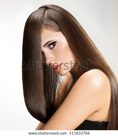 Brown Hair. Beautiful Woman with Healthy Long Hair..