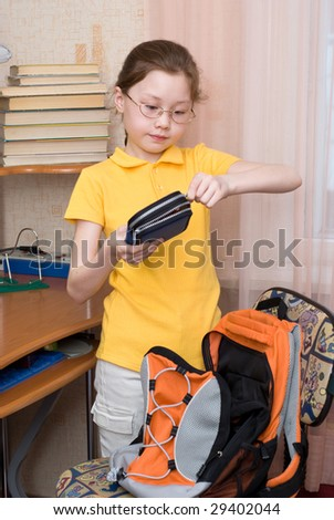 brown haired girl closing her pencil case