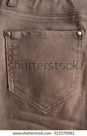 Brown jeans pocket as a background