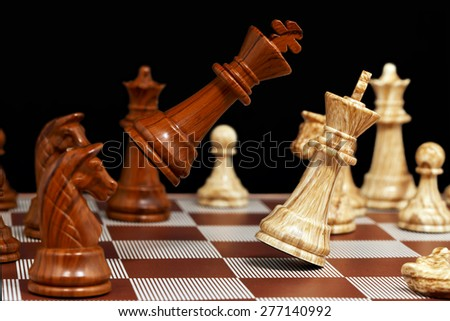 brown king is attacking the white king, high speed image  - stock photo