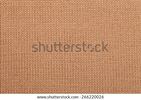 Brown knitted fabric textured background - stock photo