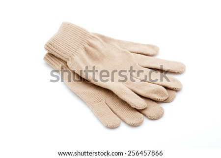 Brown knitted gloves - stock photo