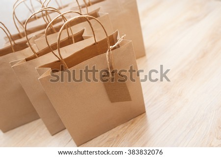 Brown kraft paper bags for gifts on background - stock photo