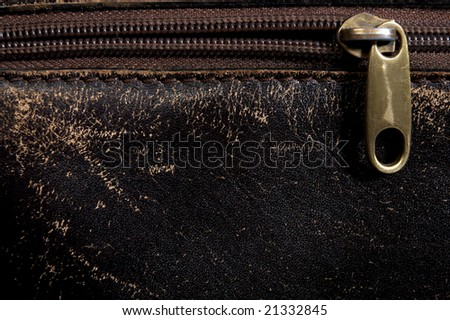 Brown leather background and zipper - stock photo