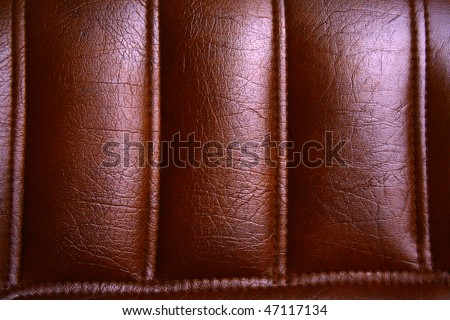 Brown leather background, close up of chair piece - stock photo