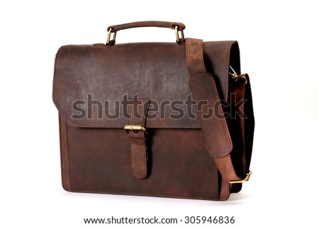 brown leather bags with antique and retro looks  made from goat's skin for travel,students,executives,ladies handbags  - isolated on white shot in different layouts straight, back, open and lay flat  - stock photo