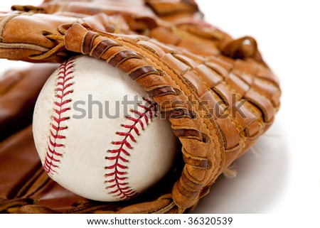 Brown leather baseball glove with a baseball on a white background