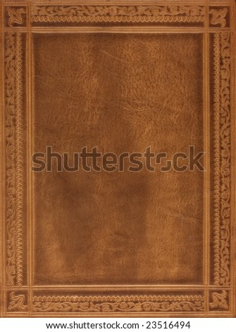 brown leather book or journal cover with a decorative floral ornament - stock photo