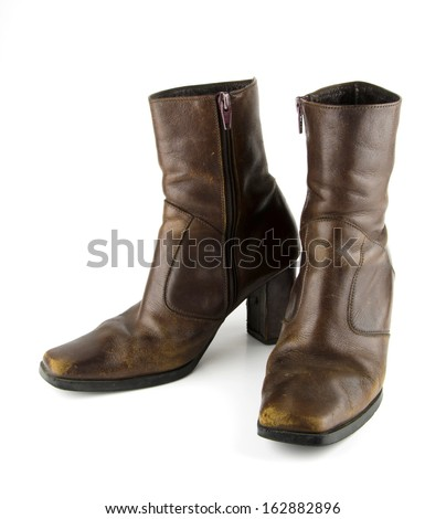Brown leather boots with a heel, but not very high abrasion of the film, which shows how many times the old used to wear it on a white background. - stock photo
