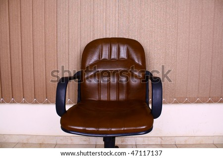 Brown leather chair inside office - stock photo