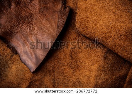 Brown Leather Cut for Concept and Idea Style of Fine Leather Crafting, Handcrafts Workspace, Handmade or Handcrafted Leather Worker. Background Textured and Wallpaper. Vintage Rustic. - stock photo