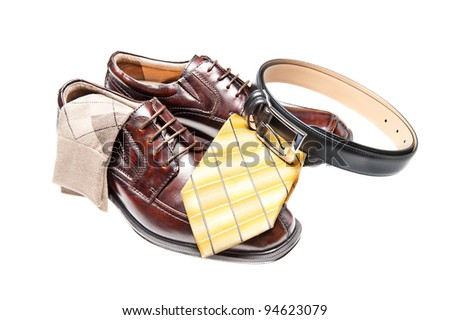 Brown leather dress shoes with argyle socks and a black belt
