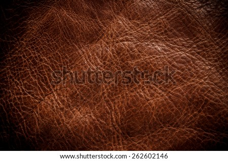 Brown Leather for Concept and Idea Style of Fine Leather Crafting, Handcrafts Workspace, Handmade or Handcrafted Leather Worker. Background Textured and Wallpaper. Vintage Rustic. Close up Full frame. - stock photo