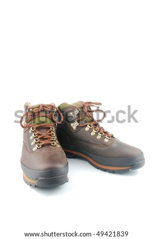 brown leather hiking boots isolated on white background - stock photo