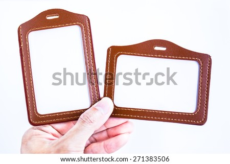Brown leather label tag with string, isolated on the white background. - stock photo