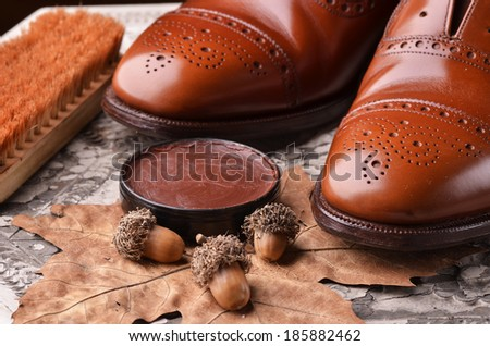 Brown leather shoes on table with polishing equipment - stock photo