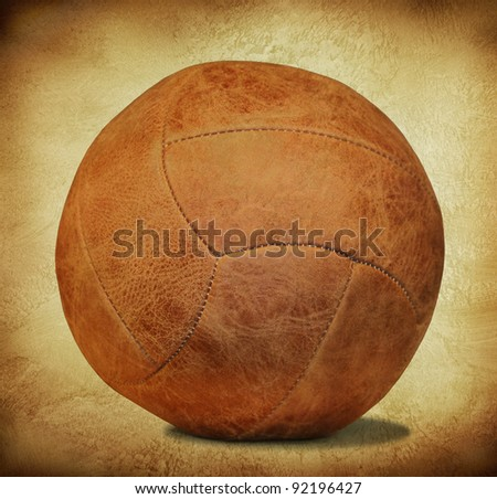 brown leather soccer ball in retro style - stock photo