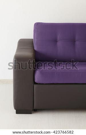 Brown leather sofa isolated against the wall - stock photo