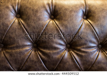 Brown leather sofa texture background. - stock photo