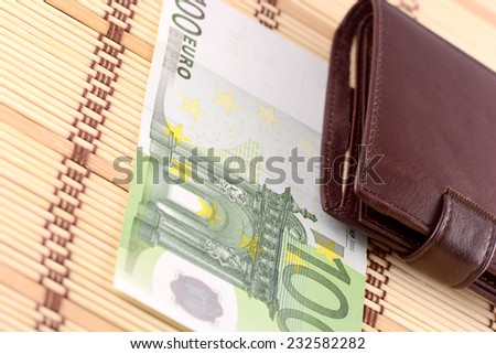 brown leather wallet with european money - stock photo